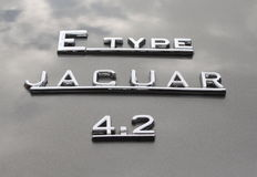 Jaguar Cars typeface. The Jaguar typeface on a classic Jaguar E Type being displayed at the annaul Motor Mania car show in Grantown-On-Spey, Scotland 4th Royalty Free Stock Images