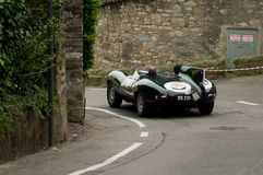 Jaguar D-Type at Bergamo Historic Grand Prix 2015. The tail of a Jaguar D-Type is disappearing down the Boccola chicane in Citta' Alta (the medieval part of Stock Photo