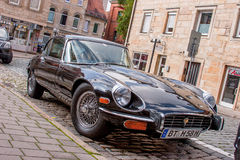Jaguar E-Type. A classic Jaguar E-Type parked in the street Stock Images