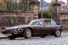 Jaguar E-Type. A classic Jaguar E-Type parked in the street Stock Photo