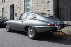 Jaguar E-Type, series 1 coupe, in metallic pearl grey silver royalty free stock images