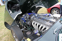 Jaguar e type v12 engine. Photo of a powerful v12 engine belonging to a sports jaguar car showing at the herne bay vintage car show Stock Images