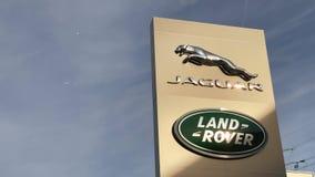 Jaguar Land Rover brand logo blue sky backgroun