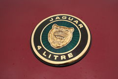 Jaguar 4 Litre Badge. Restored Badge from a Jaguar royalty free stock photos