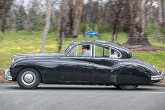 1955 Jaguar Mk VII M Saloon driving on country road Royalty Free Stock Images