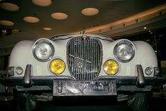 Jaguar S-type. Moscow, Russia - April 02, 2017: Front headlights and grille of a restored white Jaguar S-type, 3,8 litre, Great Britain 1965, close up frontal Royalty Free Stock Photography