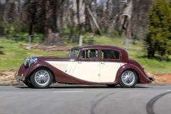 1947 Jaguar sedan driving on country road Royalty Free Stock Photos