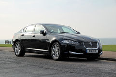 Jaguar xf car. Photo of a black jaguar xf car parked by kerb along the whitstable coast in kent Stock Photos