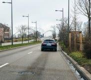 Jaguar XF luxury wagon car leaving France toward German border Stock Images