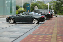 Jaguar xf parked near the office building Stock Photo