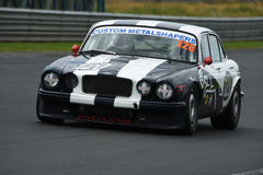Jaguar XJ12 Classic Race Car. A classic 6 liter XJ12 Jaguar from 1972 now a muscle car racer featuring in the Annual Classic Musclecar Festival in New Zealand Royalty Free Stock Photo