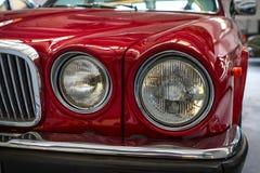 Jaguar xj6 detail. Jaguar xj6 front lights, red, detail Stock Images