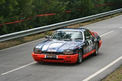 Jaguar XJS racing at Rampa da Falperra 2012 Stock Image