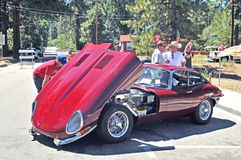 Jaguar XKE. This is a 1960`s vintage Jaguar XKE painted garnet red and it is a head-turner wherever it goes. The high performance engine had an overhead camshaft Stock Images