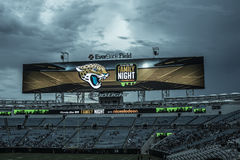 Jaguars NFL game at Everbank field stadium. The American national anthem performance on big screen before Jaguars NFL game at Everbank field stadium in Stock Photos