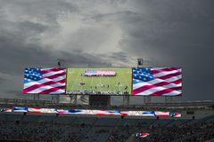 American national anthem performance on huge screen before NFL game Stock Photos