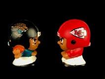 Jaguars v. Chiefs, NFL Matchup. A Jacksonville Jaguar Little One figure faces off against a Kansas City Chiefs figure royalty free stock photo