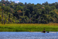 Jahai aborigine paddling a raft in Royal Belum Royalty Free Stock Images