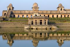 Jahaz Mahal , Ship Palace and blue water lake in sunrise. Mandu, Madhya Pradesh, India. Old Indian architecture on the background stock images