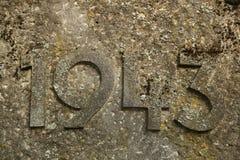Jahr 1943 geschnitzt im Stein Die Jahre des Zweiten Weltkrieges Stockfotografie