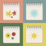 Jahreszeiten auf dem Kalender in der Weinleseart Stockfotografie