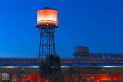 Jahrhunderthalle Bochum. Bochum, Germany - October 11, 2015: Rde illuminted water tower of the Jahrhunderthalle of Bochum, North Rhine-Wetsphalia, Germany Royalty Free Stock Image