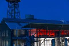 Jahrhunderthalle at Bochum. Bochum, Germany - October 11, 2015: Rde illuminted water tower of the Jahrhunderthalle of Bochum, North Rhine-Wetsphalia, Germany Royalty Free Stock Images