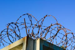 Jail barbed wire on a backgroung of blue sky stock photography