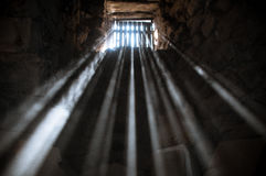 Jail cell. Sun rays beaming through the jail window into the cell Royalty Free Stock Photo