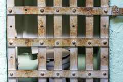 Jail cell with potty and rusted bars Stock Images