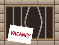 Jail Cell With Vacancy. Jail cell window has bent bars and a vacancy sign hanging from one of the bars Royalty Free Stock Photography