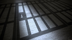 Jail cells bars casting shadows on floor. Stock Photos