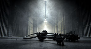 Jail Corridor And Keys. A concept image of an eerie corridor in a prison at night showing jail cells dimly illuminated by various ominous lights and a bunch of Royalty Free Stock Photo