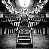 Jail Main Hall. This is the center hall of a jail in black and white Royalty Free Stock Photo