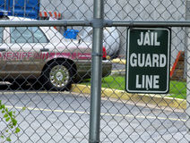 Jail sign. Jail Guard Line Sign with sheriff car in the background stock images