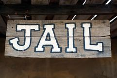 Jail sign. An old-fashioned Western jail sign stock image