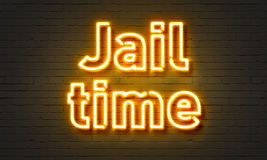 Jail time neon sign on brick wall background. Stock Photos