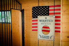 Jail and Wanted Sign in Texas with american flag on the backgrou Stock Images