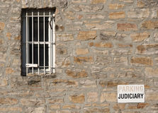 Jail Window Judiciary Parking. A barred window and judiciary parking sign at the courthouse and jail in Perth, Ontario, Canada royalty free stock photo
