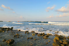 Jailbreaks surfing spot with waves in evening on Himmafushi island, Maldives Stock Images