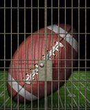 Jailed Football. Digital illustration of a football in a jail cell Royalty Free Stock Photography