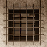 Jailhouse window with iron grille Stock Photo