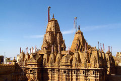 Jain temple in India, Jainism. Jain temple in India. Jainism religious building of sandstone with domes and ornaments on the roof and sculptures on the wall stock images