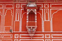 Jaipur City Palace. Small decorative balcony on Jaipur City Palace. The City Palace architecture achieved a fusion of the Shilpa Shastra of Indian architecture royalty free stock photography