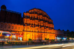 Jaipur, India. Illuminated Palace of Winds Hawa Mahal. In Jaipur, India at night. Popular touristic landmark, car traffic trails, souvenir shops, dark blue sky royalty free stock photo
