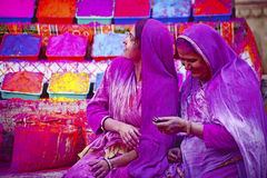 JAIPUR, INDIA - MARCH 17: Lady in violet, covered in paint on Holi festival, March 17, 2013, Jaipur, India. Holi, the festival o