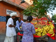 Vendor selling fruits in Jaipur, India. Jaipur, India - Nov 1, 2017. People selling fruits at downtown in Jaipur, India. Jaipur is the capital and the largest Stock Images