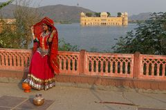 Indian woman in red at Water palace. Royalty Free Stock Image