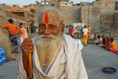 An old sadhu smiling on the terrace Stock Image