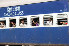 Passengers sitting at the windows of an Indian Railway wagon Royalty Free Stock Photography